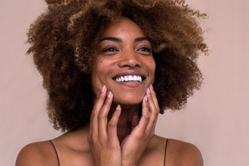 Black woman with natural hair smili
